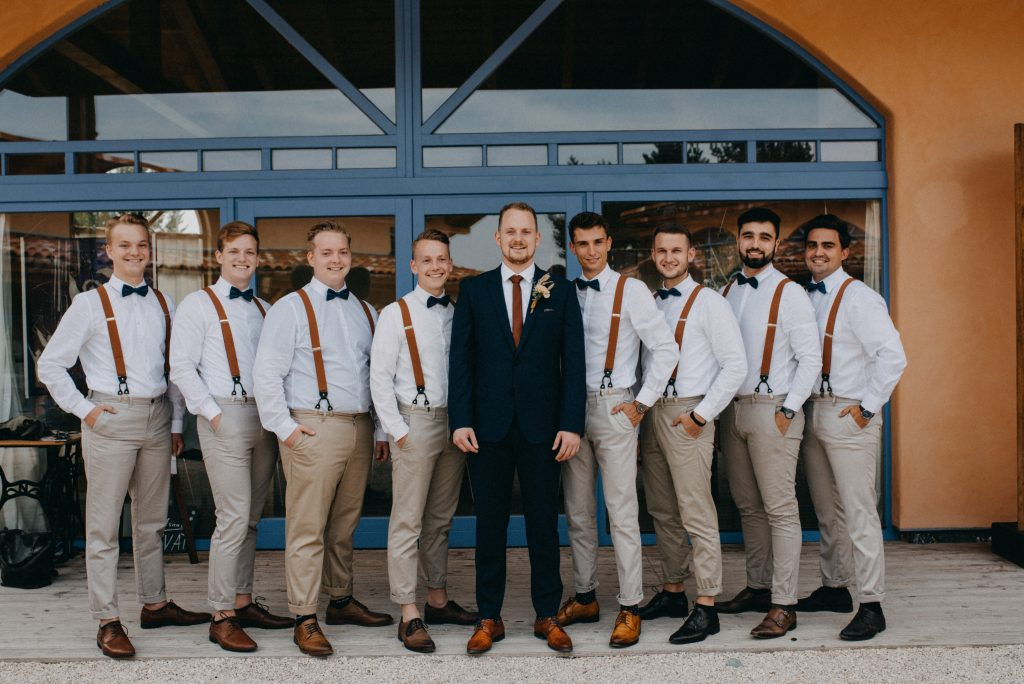 German vineyard wedding with boho touches groomsmen